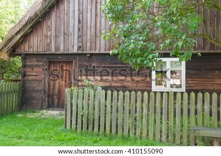 wooden cottage in village- Poland, Europe - stock photo