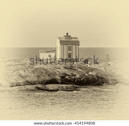 Wooden cottage on the island in the archipelago of the Aland Islands, Finland (stylized retro) - stock photo