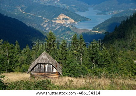 Wooden cottages and lakes, National park Tara