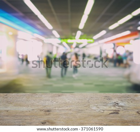 wooden counter top with blurred walk way to boarding gate at airport - stock photo