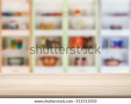 wooden counter top with kitchen cabinet background - stock photo