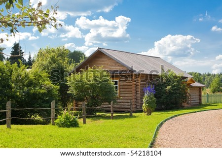 wooden country house with front garden. horizontal shot