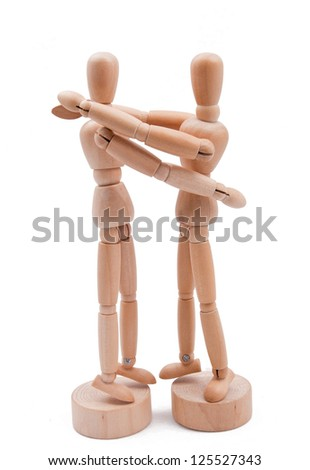 Wooden couple embrace