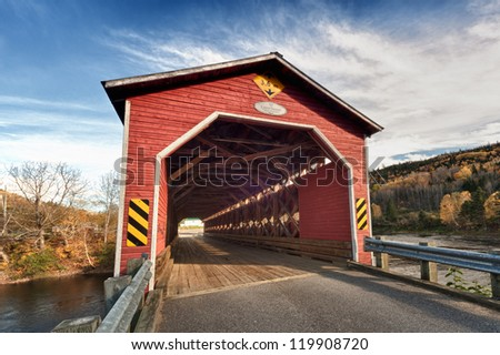 Wooden covered bridge in New Brunswick Canada - stock photo