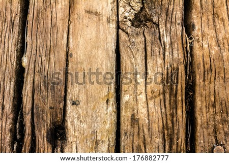 Wooden cracked texture background tiles  in same directions.