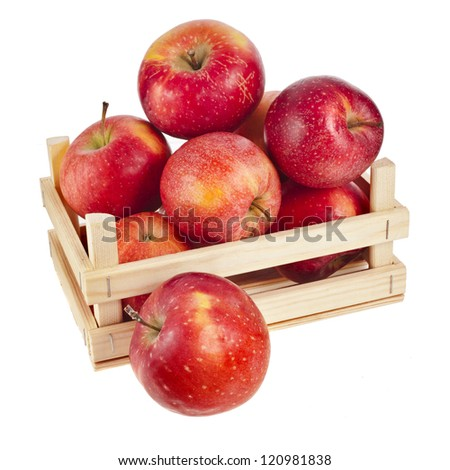 Wooden crate box full of fresh apples isolated on a white background