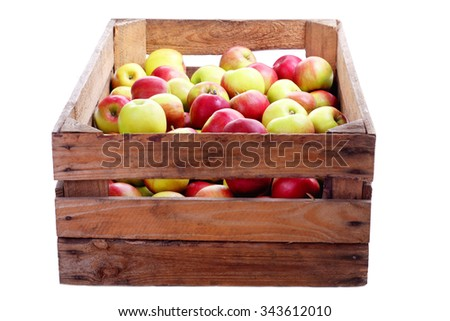 wooden crate box full of fresh apples on white - fruits and vegetables - stock photo