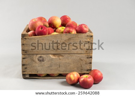Wooden crate full of apples with space for text - stock photo