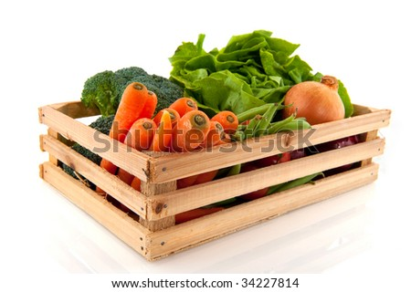 Wooden crate with a diversity of daily vegetables
