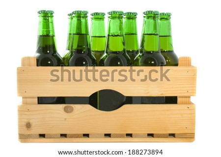 Wooden crate with beer bottles isolated over white