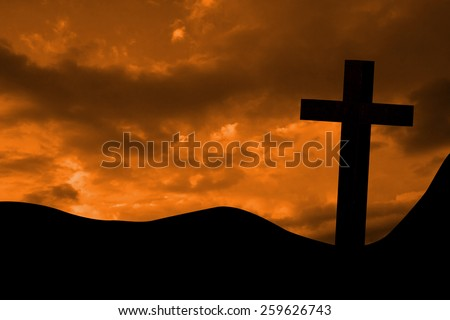 Wooden cross against clouds