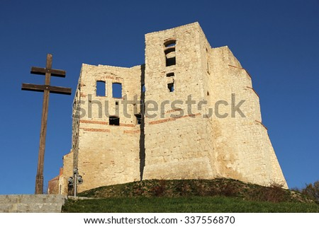 wooden cross and castle ruins in Kazimierz Dolny, Poland