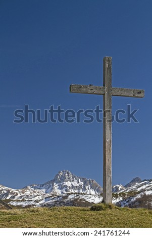 Wooden cross in Piora valley, a side valley of the Levantine - stock photo