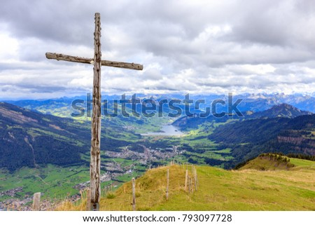 Wooden cross near the summit of Mount Rigi Kulm (also known as Queen of the Mountains), a mountain massif of the Alps, Central Switzerland.