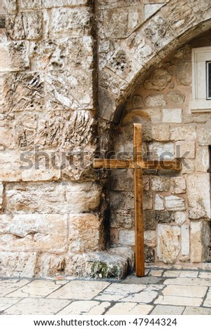 Wooden cross near the wall in old city of Jerusalem - stock photo