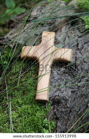 Wooden cross of olive wood - card for mourning and death - stock photo
