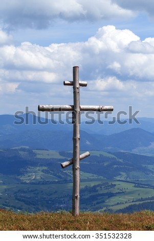 Wooden cross on a dramatic sky background.