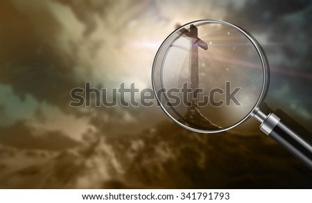 wooden cross on a hill at sunset