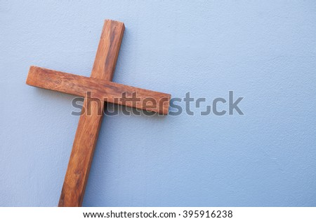 wooden cross on gray background.