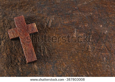 Wooden cross on old wooden board