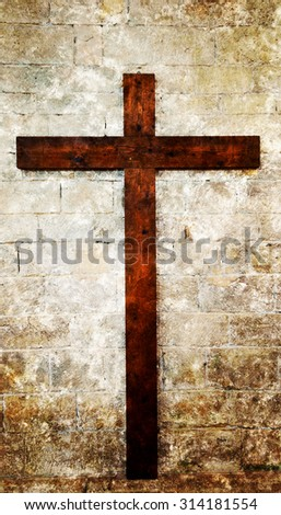 Wooden cross on stone brick wall. Retro aged photo with scratches. - stock photo