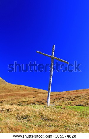 Wooden cross on the Sella Pass (2240m) in the Dolomites, Italien Alps, South Tyrol, Italy
