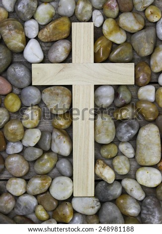 Wooden cross surrounded by stone background - stock photo