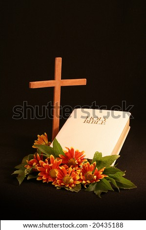 wooden cross, white bible, autumn flowers with room for copy