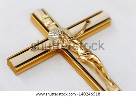 Wooden cross with Jesus Christ on the table, focused to Jesus face - stock photo