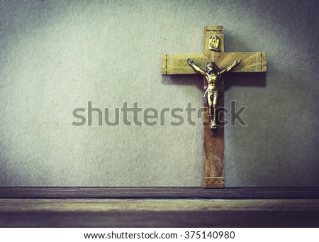 wooden cross with the crucifix of Jesus Christ  on wooden background - stock photo