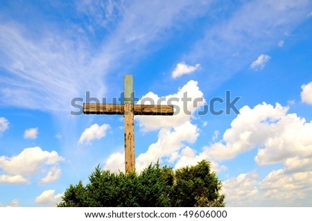 Wooden crucifix against blue sky