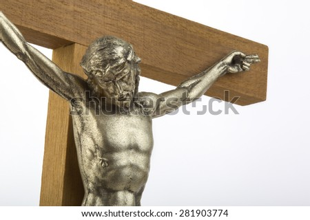 Wooden crucifix with effigy of Christ, closeup, horizontal format - stock photo