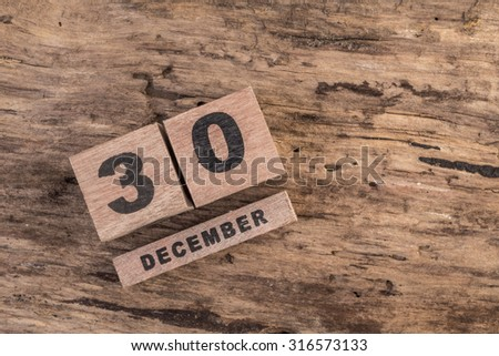 wooden cube calendar for december on wooden background