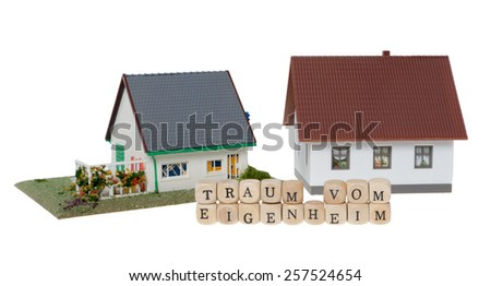 Wooden cubes and the german words dream of home ownership isolated over a white background / home ownership - stock photo