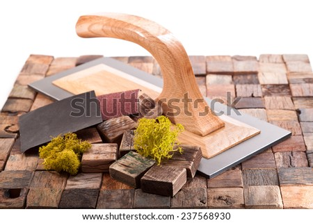 Wooden cubes assembled in tiles, moss, trowel on a white background - stock photo