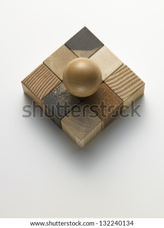 wooden cubes in a box on a white background - stock photo