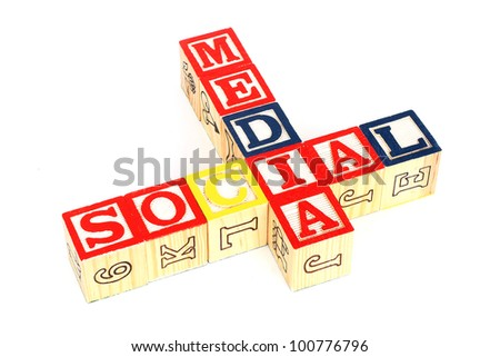 "Wooden cubes made words ""social media"" on white background"