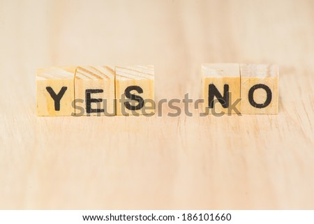 "Wooden cubic word ""YES or NO"" on wood background - stock photo"