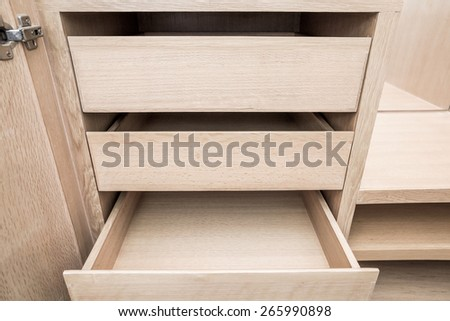 wooden cupboard opened empty drawers - stock photo