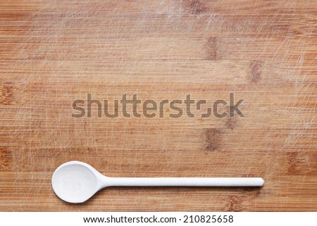 wooden cutlery on cutting board - stock photo