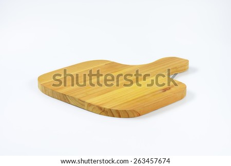 Wooden cutting board on white background - stock photo