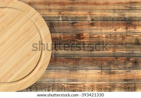 Wooden cutting board, top view - stock photo