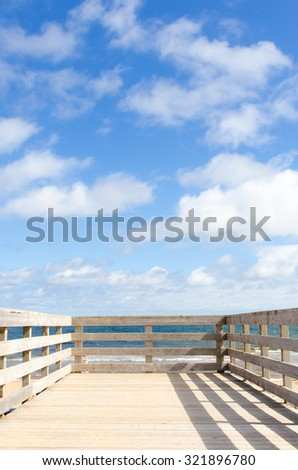 Wooden deck and blue sky - stock photo