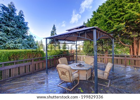 Wooden Deck With Railings And Gazebo Fire Pit Chairs