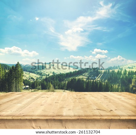 Wooden desk  and panorama of early spring in the mountains. Carpathian, Ukraine, Europe - stock photo