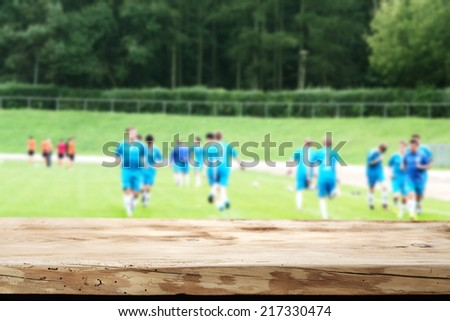 wooden desk and sport  - stock photo