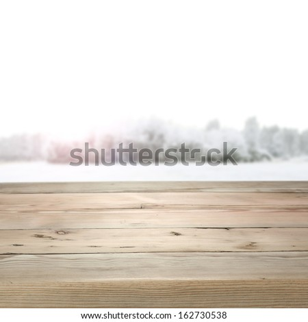 wooden desk and winter space  - stock photo