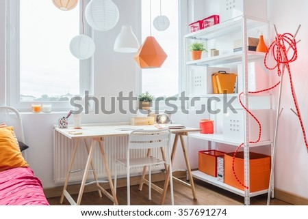 Wooden desk in homely room for teenage girl - stock photo