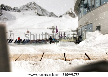 Wooden desk of free space and snow decoration and mountains landscape and ski time