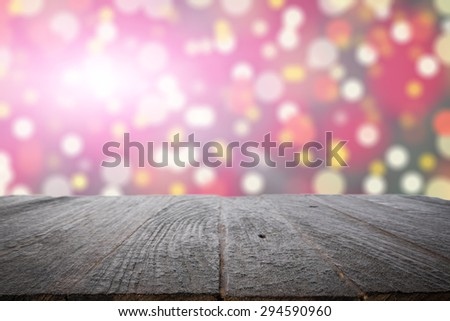 wooden desk platform and colorful bokeh - stock photo